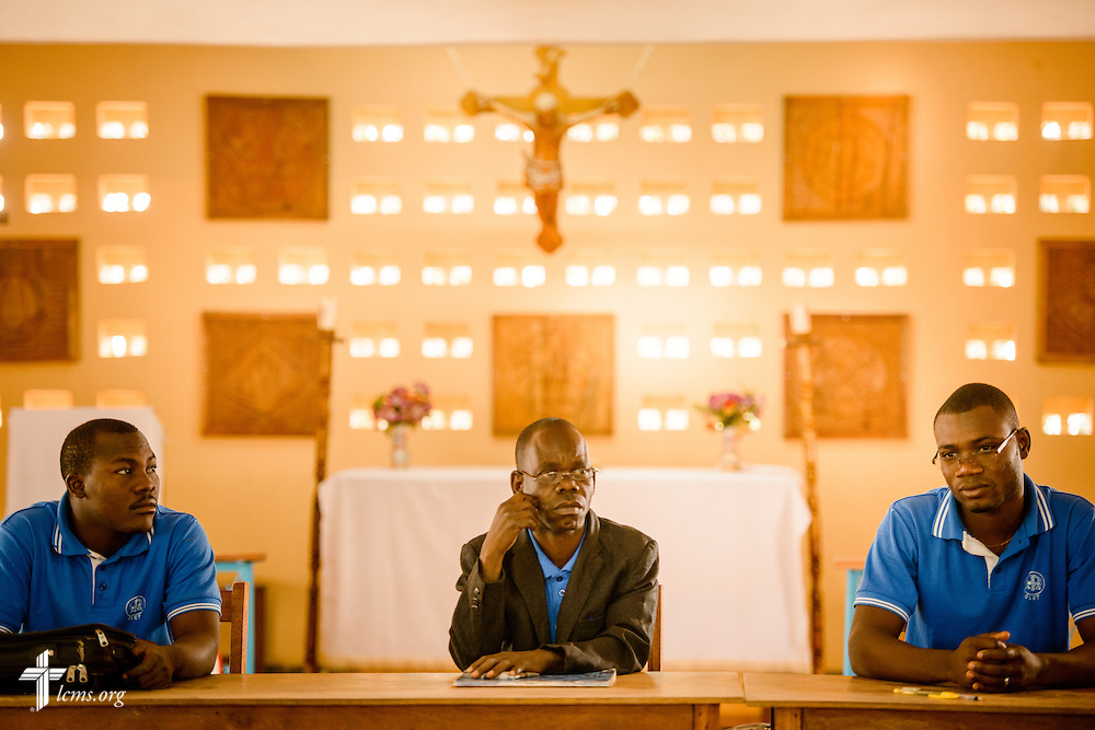 Students listen before an exam at the Lutheran Center for Theological Studies (CLET) on Wednesday, Feb. 15, 2017, in Dapaong, Togo. The sanctuary is behind them. LCMS Communications/Erik M. Lunsford