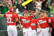 SAN JUAN, PUERTO RICO FEBRUARY 3: Players for Mexico come out of the dugout to celebrate with outfielder Maxwell Leon during the game against Puerto Rico on February 3, 2015 in San Juan, Puerto Rico at Hiram Bithorn Stadium(Photo by Jean Fruth)