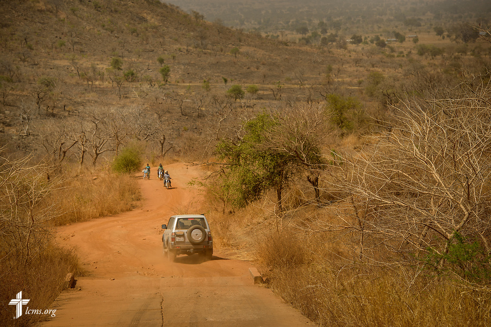 The Rev. Micah Wildauer, LCMS missionary to Togo, navigates the road with his family to Dapaong from Lokpano following a church visitation on Monday, Feb. 13, 2017, in Togo. LCMS Communications/Erik M. Lunsford
