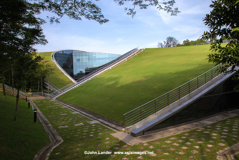 The Nanyang Technology University - School of Art, Design and Media building was conceived as natural extensions of the earth. The highlight of the building is the verdant green roof which blends with the ground contour. Apart from its visual impact, the  iconic turfed roofscape is also an outdoor communal space. Environmentally, the green roof helps to lower the building temperature as well as the surrounding areas.