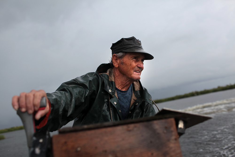 Thomas Gonzales, 72, gator hunting in the bayou off Delacroix Island, LA on August 31, 2010. Thomas is one of the only Delacroix fishermen not working for BP.