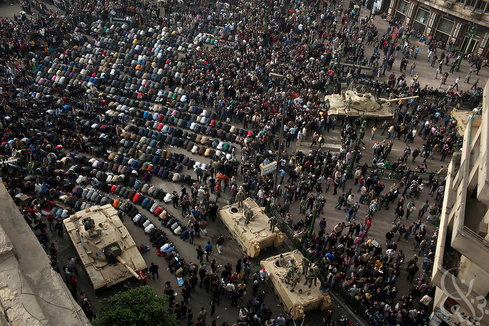 Egyptian protesters take time out from demonstrating to pray in the street near deployed Egyptian military vehicles in central Tahrir square in downtown Cairo January 29, 2011. The widespread protests across Egypt are an unprecedented challenge to the rule of President Hosni Mubarak.