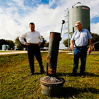 BRADENTON, FL -- January 13, 2009 -- Bryan Lembke, senior manager of package innovation with Pepsico, and Rick Langford, field representative of fruit procurement for Tropicana, look at a smudge pot, an old oil burning frost prevention tool which has been replaced with newer, cheaper, and greener technology, at SMR Farms, one of over 100 growers in Florida Tropicana gets its oranges from, in Bradenton, Fla., on Tuesday, January 13, 2009.   Pepsico has paired up with Carbon Trust to measure their carbon footprint in the making of Tropicana Pure Premium Orange Juice, a task they are going to apply to their other brands.  (Chip Litherland for The New York Times)
