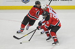 April 24, 2012; Newark, NJ, USA; New Jersey Devils defenseman Marek Zidlicky (2) and New Jersey Devils left wing Zach Parise (9) hit Florida Panthers center John Madden (10) during the third period of game six of the 2012 Eastern Conference quarterfinals at the Prudential Center.