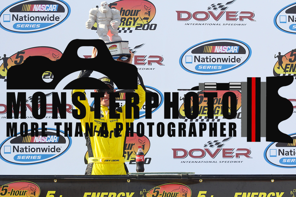 Joey Logano (22) of team Hertz poses with the monster miles trophy after winning the NASCAR Nationwide Series 5-HOUR ENERGY 200 auto race at Dover International Speedway in Dover, DE., Saturday,  June 01, 2013.