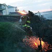 A fast-moving brush fire near Columbia Village in Southeast Boise destoryed 10 homes, seriously damanged 9, and resulted in one death.