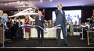 Actor Hugh Bonneville opens the Sunseeker stand at the London Boat Show 2016, as Robert Braithwaite, the company's founder looks on. Bonneville is best known for playing Robert Crawley, Earl of Grantham in the ITV period drama series Downton Abbey. <br /> Picture date: Friday January 8, 2016.<br /> Photograph by Christopher Ison &copy;<br /> 07544044177<br /> chris@christopherison.com<br /> www.christopherison.com