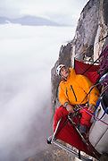 Leo Houlding belaying on a portaledge, Monte Brento, Italy