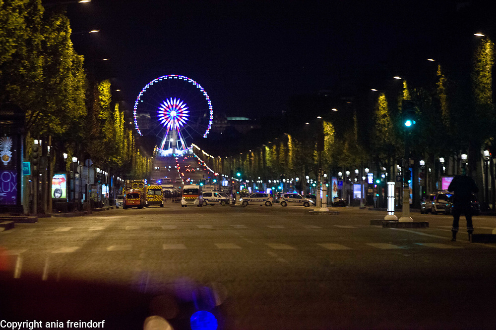 Terror Attack Champs Elysee, police officer and suspect shot dead on Champs Elysees in attack claimed by Islamic State, one tourist woman injured, another french police officer badly injured, Paris, France, empty Champs Elysee