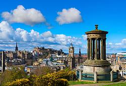 View of Dugald Stewart monument on Calton Hill and skyline of Edinburgh, Scotland