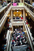 Union workers march into the State Capitol on February 23, 2011 in Madison, Wisconsin.
