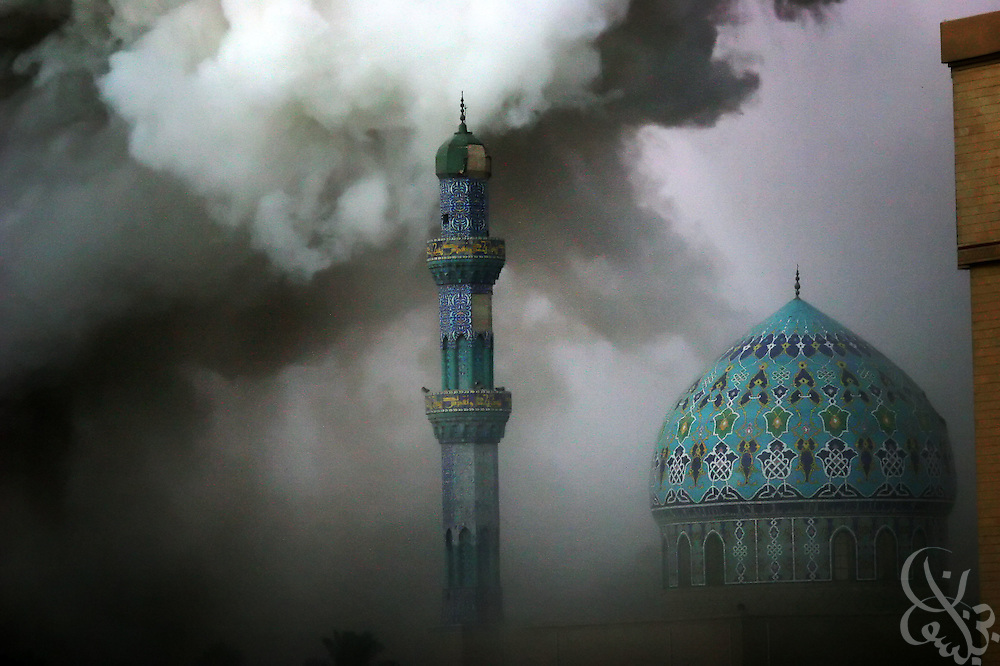 BAGHDAD, IRAQ - OCTOBER 24, 2005:  Smoke rises above the Al-Fardus mosque in Fardus square in central Baghdad after an apparent triple suicide car bombing October 24, 2005.  The bombs apparently targeted the nearby Palestine and Sheraton hotels, home to journalists, security personel and private contractors. (Photo by Scott Nelson/WPN for the New York Times)