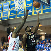 """Erie BayHawks Guard Scott Suggs (15) drive toward the basket as Delaware 87ers Forward Keith """"Tiny"""" Gallon (41) defends in the first half of a NBA D-league regular season basketball game between Delaware 87ers (76ers) and the Erie BayHawks (Knicks) Friday, Jan. 3, 2014 at The Bob Carpenter Sports Convocation Center, Newark, DE"""