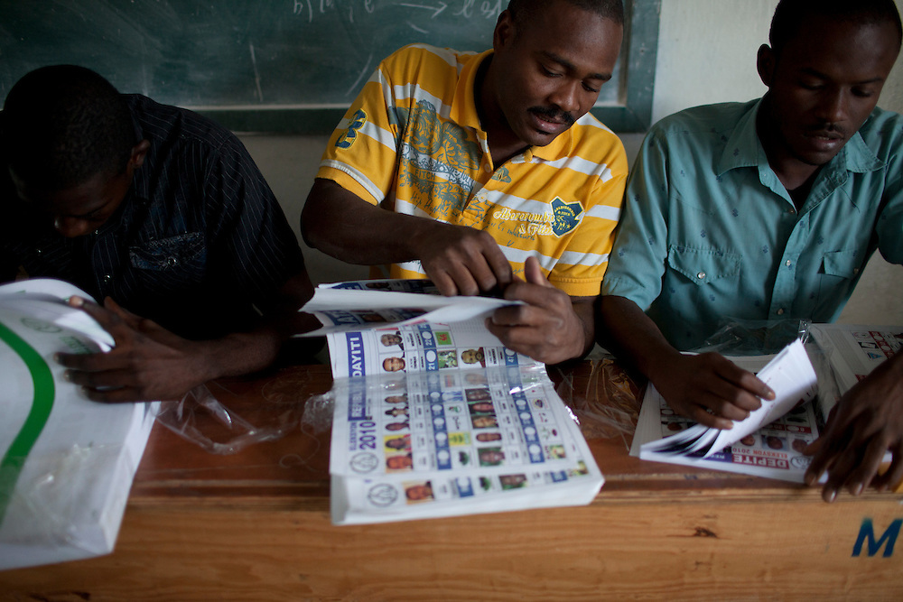 Poll workers prepare ballots for presidential and legislative elections on November 28, 2010 in Port-au-Prince, Haiti.