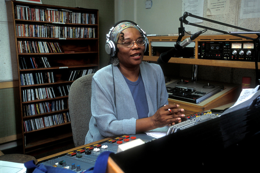 Rose Willock on her Saturday morning Radio Montserrat show. Rose played a vital role in informing the population during the volcano crisis. Thousands were evacuated from their homes in the south of the island after it was abandoned after the 1995 and 1997 eruption of the Soufriere Hills volcano. The southern area which contained most of the farm land is still out of bounds to everyone except scientists..Photo©Steve Forrest/Workers Photos