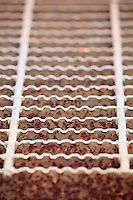 A patterned photograph of a metal grate.