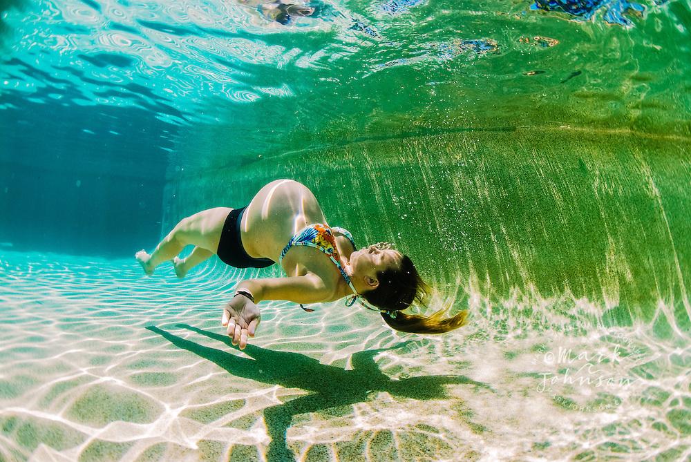 Brisbane, Australia --- Pregnant Woman in Swimming Pool