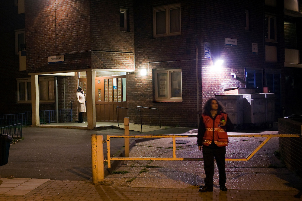 A Community warden on a housing estates in Southwark near the Walworth road, South London. The area one of the most densely populated areas in Europe and house mainly ethnic minorities.