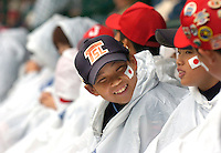 Jodi Miller.Players and family of the Japan Little League team waiting in Lamade Stadium wearing ponchos for Monday's first game to start. All of Monday's games were rained out.