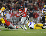 Mississippi running back Jaylen Walton (6) runs 26 yards for a touchdown as LSU's Craig Loston (6) chases at Vaught-Hemingway Stadium in Oxford, Miss. on Saturday, October 19, 2013. Mississippi won 27-24. (AP Photo/Oxford Eagle, Bruce Newman)
