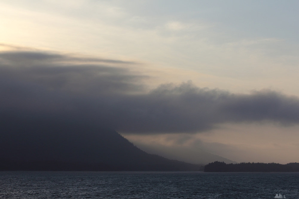 Sea fog covers the top of hills along the Inside Passage as we approach Prince Rupert at sunset