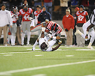 Ole Miss wide receiver Donte Moncrief (12) makes a 42 yard reception in the first quarter as Mississippi State defensive back Johnthan Banks (13) defends at Vaught Hemingway Stadium in Oxford, Miss. on Saturday, November 24, 2012. Ole Miss won 41-24.