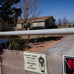 A sign is seen outside the home of the arm's dealer where Columbus government officials were purchasing arms to sell in Mexico is seen in Chaparral, New Mexico. Recently federal authorities arrested the mayor, police chief, and trustees of Columbus New Mexico who were allegedly operating an illegal gun running ring.