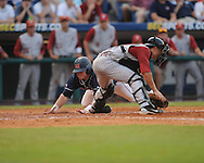 Mississippi's Matt Smith scores vs. Alabama catcher Brock Bennett during the Southeastern Conference tournament at Regions Park in Hoover, Ala. on Thursday, May 27, 2010. Alabama won 6-3. (AP Photo/Oxford Eagle, Bruce Newman)