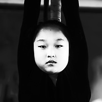 Wuqiao, April 20, 2016 : a young  acrobats ' apprentee hangs from a barre for about 30 minutes during daily excercises . Students who fail these kind of basic training  won't make it into a professional troupe. <br /> Acrobatic performances belong to Chinas variety arts and have existed for centuries. Acrobats originally were to entertain poor villagers in the countryside. Nowadays it's a profession for young people from the countryside seeking a better life in China's big cities where they lead a life as outcasts. Their monthly income is not enough to participate in social life , let alone to have private lifes. The troupes often live together in basic housing such as dorms and it's difficult to break out.