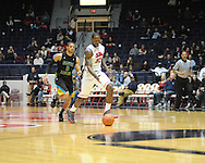 "Ole Miss' Murphy Holloway (31) vs. Coastal Carolina's Warren Gillis (0) at the C.M. ""Tad"" Smith Coliseum in Oxford, Miss. on Tuesday, November 13, 2012. (AP Photo/Oxford Eagle, Bruce Newman)"