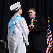 Conrad Schools of Science graduate Kevin Ellis receives his diploma during Conrad commencement exercises Saturday, June 06, 2015, at The Bob Carpenter Sports Convocation Center in Newark, Delaware.