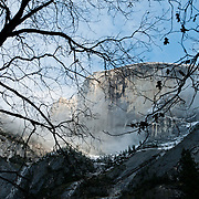 The granite monolith of Half Dome (8836 feet or 2693 meters elevation) is a famous symbol of Yosemite National Park, Sierra Nevada, California, USA. The peak rises 4737 ft (1444 m) above the valley floor. Designated a World Heritage Site by UNESCO in 1984, Yosemite is internationally recognized for its spectacular granite cliffs, waterfalls, clear streams, Giant Sequoia groves, and biological diversity. 100 million years ago, the Sierra Nevada crystallized into granite from magma 5 miles underground. The range started uplifting 4 million years ago, and glaciers eroded the landscape seen today in Yosemite.