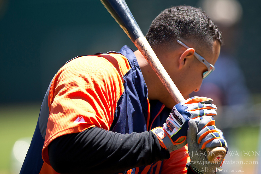 OAKLAND, CA - MAY 26:  Miguel Cabrera #24 of the Detroit Tigers holds a bat with Franklin batting gloves during batting practice before the game against the Oakland Athletics at O.co Coliseum on May 26, 2014 in Oakland, California. The Oakland Athletics defeated the Detroit Tigers 10-0.  (Photo by Jason O. Watson/Getty Images) *** Local Caption *** Miguel Cabrera