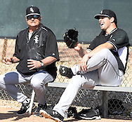 GLENDALE, AZ - FEBRUARY 24:  Pitching coach Don Cooper (L) shares a light moment with Carlos Rodon #80 of the Chicago White Sox during spring training workouts on February 24, 2015 at The Ballpark at Camelback Ranch in Glendale, Arizona. (Photo by Ron Vesely)   Subject:   Don Cooper; Carlos Rodon