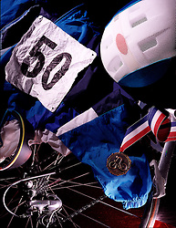 still life bicycle racer racing helmet identity identification number 50 medallion award