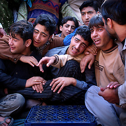 The relatives and neighbors of Muzzamil Ahmad, a 19-year-old Muslim who was killed when he was hit by an Indian security force vehicle, mourn his death in Srinagar, the summer capital of Kashmir September 28.