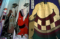 The Kappabashi district of Tokyo, Japan is where goods for use in restaurants, such as these traditional noren curtains with designs of geisha and sumo wrestlers, are sold.