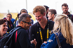 Queen Elizabeth Olympic Park, London. September 13th 2014. Prince Harry chats with a competitor as wounded servicemen and women from 13 different countries compete for sporting glory during the cycling competition at the Invictus Games.