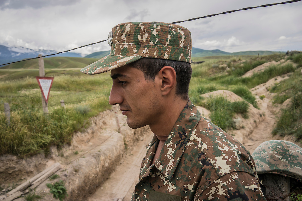 A soldier from the Nagorno-Karabakh armed forces at a front-line post on Sunday, May 8, 2016 near Talish, Nagorno-Karabakh. It was estimated that Azerbaijani military forces were stationed approximately 100 meters away.