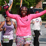 Cozette Teasley (2158) of Lawrenceville, GA., celebrates finishing the 13th Annual Discover Bank Delaware Marathon Sunday, May 8, 2016, at Tubman Garrett Riverfront Park, in Wilmington Delaware.