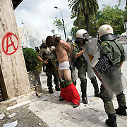 A protester is caught with his pants down amongst the clashes with poilce in the side streets of Athens, Greece. The MPs in parliament prepare to debate new austerity measures required for the EU and IMF bail-out package.  Athens turned into a war zone with many arrests and tear gas thrown by the police.  Image © Angelos Giotopoulos/Falcon Photo Agency