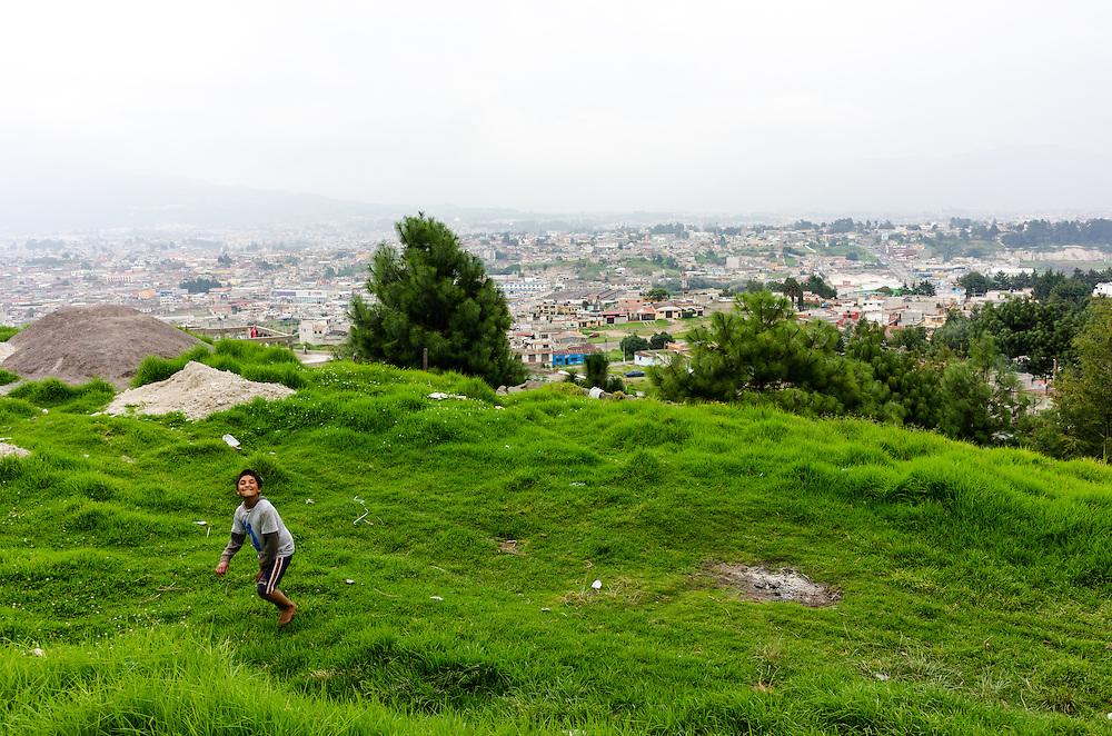 A boy plays on the base of El Baúl.