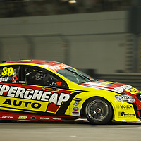 russell ingall (supercheap auto racing) during YAS V8 400  in yas marina circuit, abu dhabi UAE.11 february 2011.winners Jamie Whincup - team vodaphone (1), Alex davidson - irwin racing (2), makr winterbottom - orrcon steel fpr falcon (3)...real action heroes event..Providing the action for the main event are the Australian V8 Supercars, a two-car series of makers Holden and Ford - a close rivalry that runs deep in Australian culture. This season, that rivalry is heightened by the switch of 2010 series Champion James Courtney, who drives with the coveted No.1 plate, from his winning 2010 Ford Falcon to the Holden Commodore for 2011.