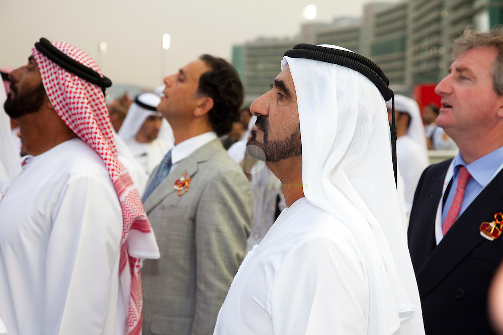 His Highness Sheikh Mohammed bin Rashid Al Maktoum (center) watches a race at the Dubai World Cup 2010, taking place at the new Meydan racecourse in Dubai.