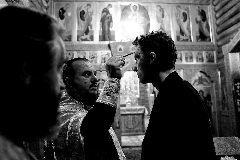 Valera, a former drug user who is now in a rehabilitation program run by the orthodox church, receives a blessing at a church service at a live-in retreat in Sapernoe, Russia, on Saturday, September 15, 2007. About a dozen people at a time live and work at the remote farm, about two hours from St. Petersburg, for a free one year course of treatment.