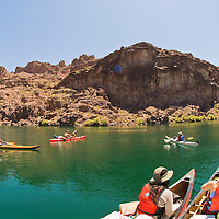 Paddlers float downstream in The Black Canyon, Nevada.