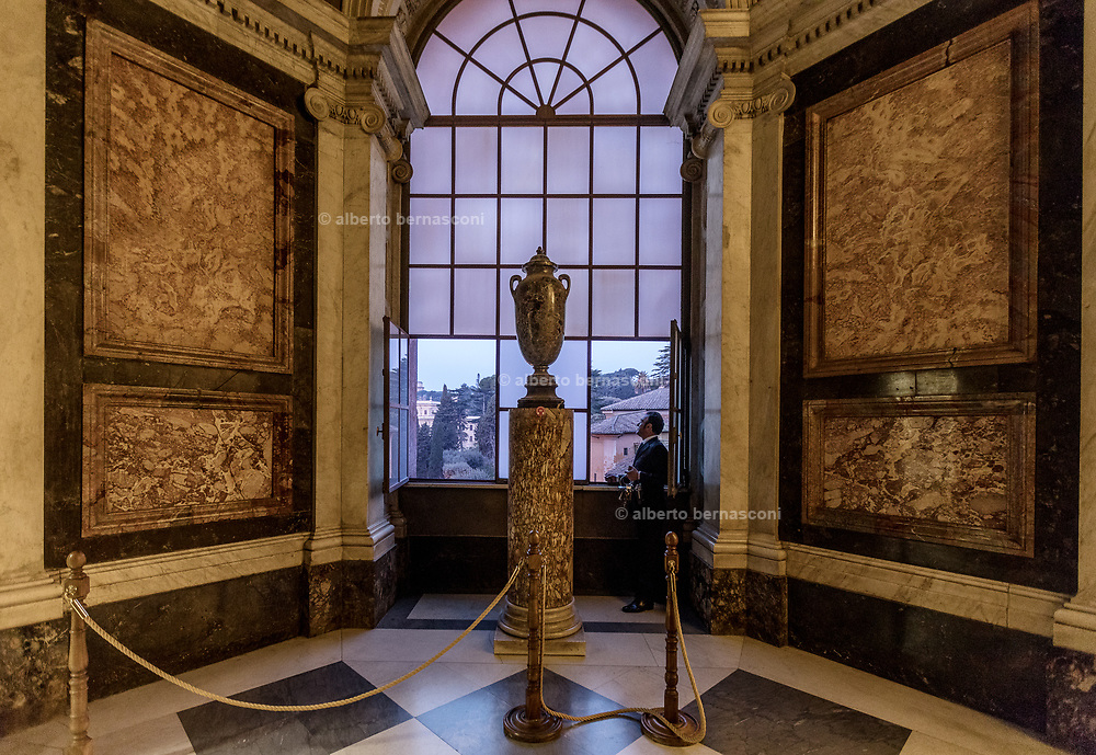 Rome, Vatican Museums, Giovanni Crea opening the window early in the morning, his shift starts at 5.30 am at the Cappella Di S. Pio V