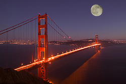 USA, Marin, California A digitally-composited moonrise above the Golden Gate Bridge and downtown San Francisco, seen from the Marin headlands. Credit as: © Josh Anon / Jaynes Gallery / DanitaDelimont.com