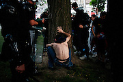 A young man is arrested by Belgrade police in a park in central Belgrade following a chase. At least two sling-shots were found on the group, prompting the arrest. (No further details available at this time)...Matt Lutton for The New York Times..Capture of Ratko Mladic. Belgrade, Serbia. May 26, 2011.
