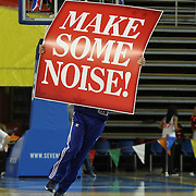 """A member of the Philadelphia 76ers flight squad performs with signs that reads """"Make Some Noise"""" during a time out of a NBA D-league regular season basketball game between Delaware 87ers (76ers) and the Erie BayHawks (Knicks) Friday, Jan. 3, 2014 at The Bob Carpenter Sports Convocation Center, Newark, DE"""